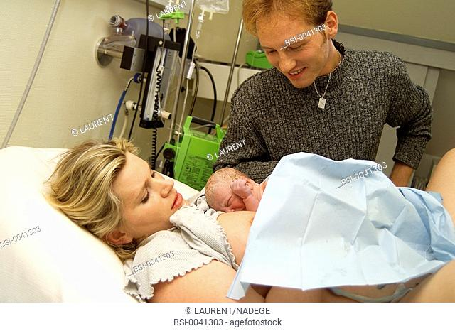 DELIVERY<BR>Newborn with parents in the delivery room