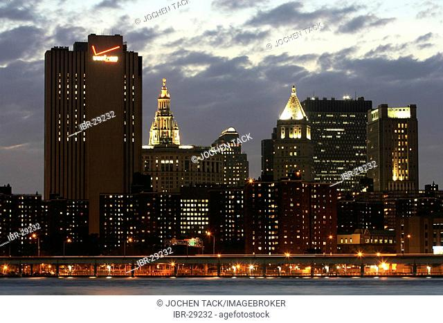USA, United States of America, New York City: Skyline of south Manhattan, at dusk. View from Brooklyn, East River