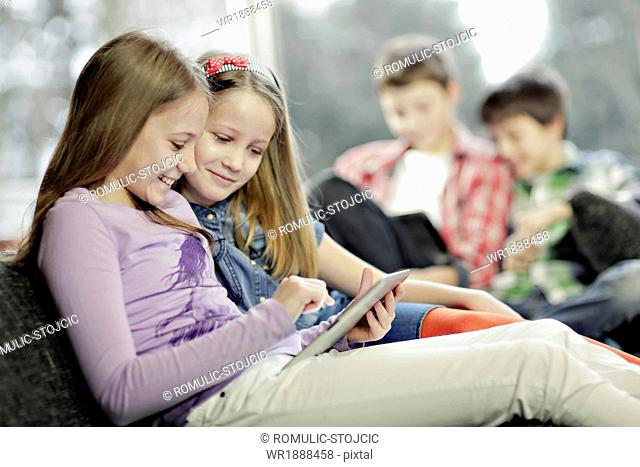 Children using digital tablet, Osijek, Croatia, Europe
