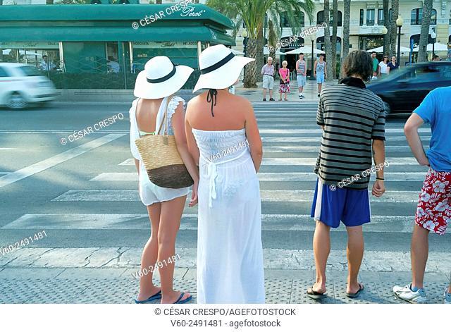 -Turist women ready to cross the street- Alicante (Spain)