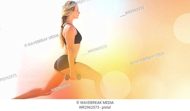 Side view of woman exercising by bokeh