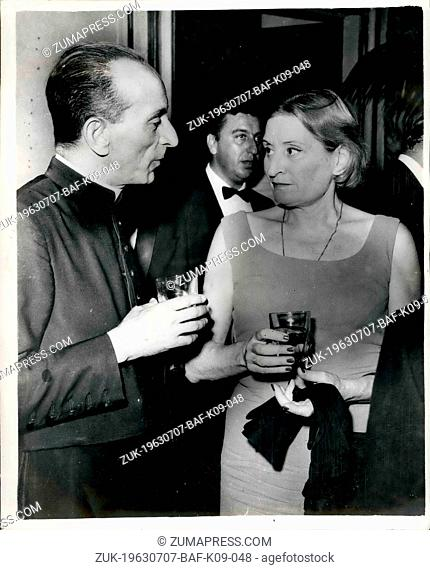 Jul. 07, 1963 - Mussolini's daughter at Embassy reception in Rome: Photo shows Countess Edda Ciano, daughter of Mussolini, and Monsignor Blancho
