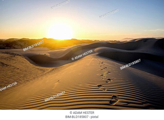 Footprints in desert sand dunes