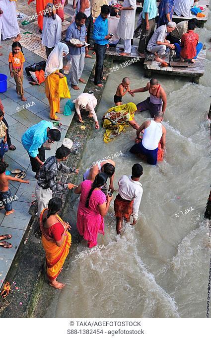 Pilgrims at Har Ki Pairi ghat by the Ganges River