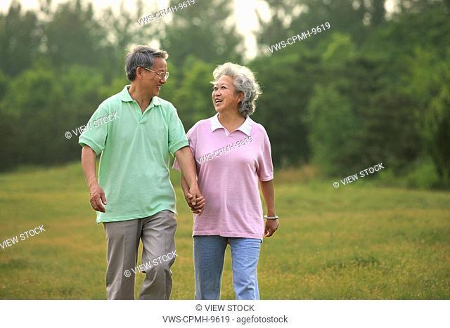 Chinese Senior Couple Picnicing Outdoors,Beijing,China