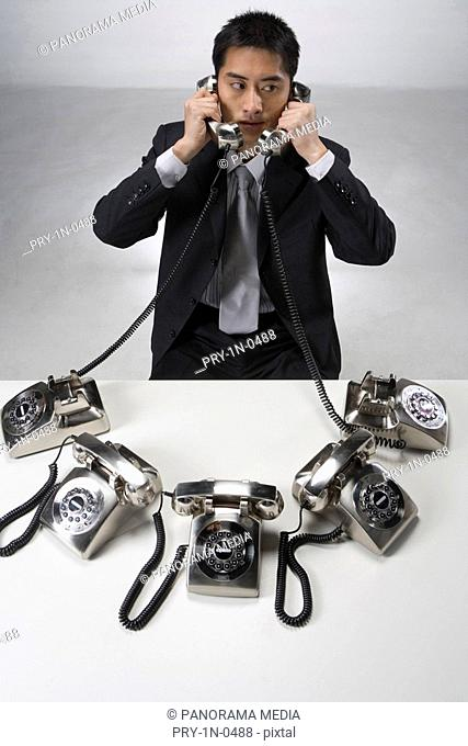 Businessman using telephone, elevated view