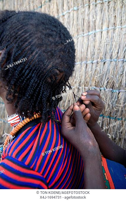 Girls are plaiting each otherÂ's hair This ceremony takes at least 2 hours but is a popular activity among Ethiopian girls