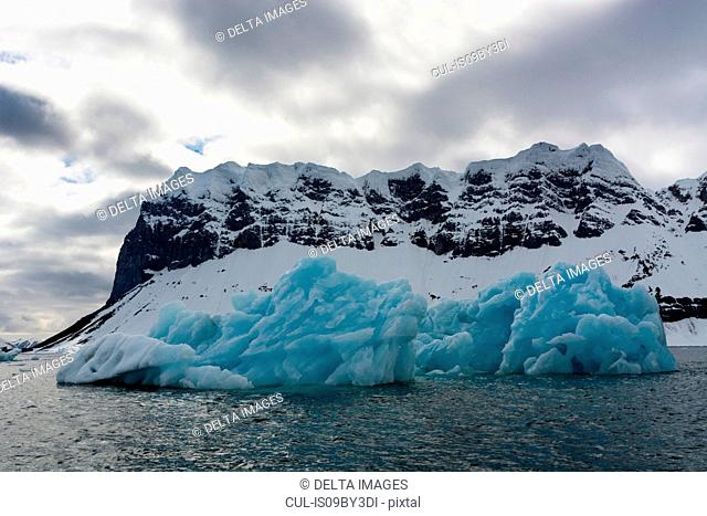 View of blue iceberg on coast, Burgerbukta, Spitsbergen, Svalbard, Norway