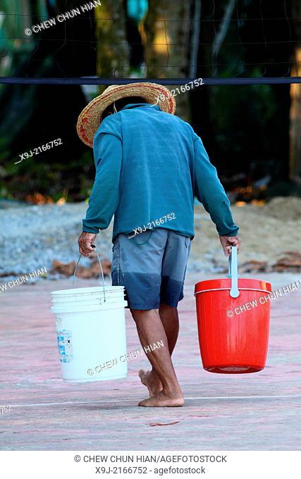 Man carrying pails, Sarawak, Borneo, Malaysia