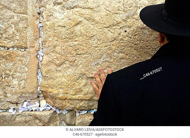 Orthodox Jew praying by the Wailing Wall 'Western Wall' , Jerusalem. Israel
