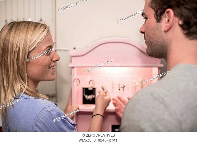 Young couple looking at jewelry in a jewelry store
