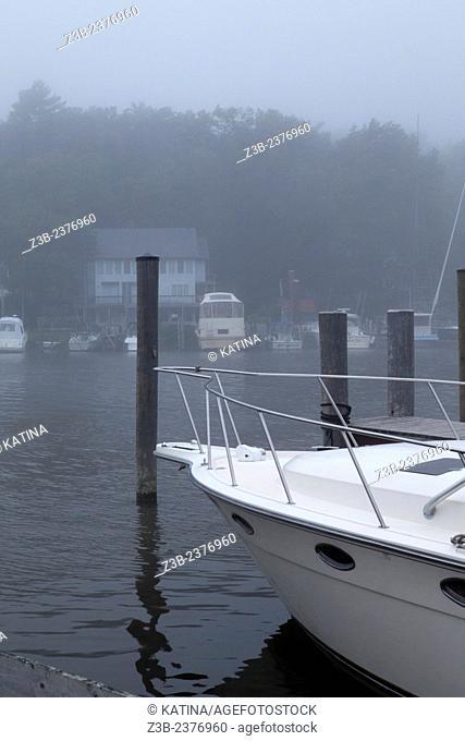 Foggy harbor on the Kalamazoo River near Lake MIchigan, Saugatuck, Michigan, MI, USA