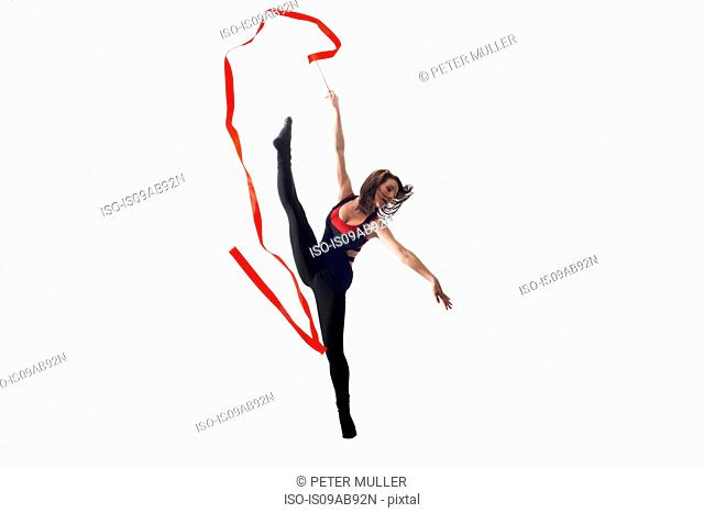 Dancer with ribbon on white background