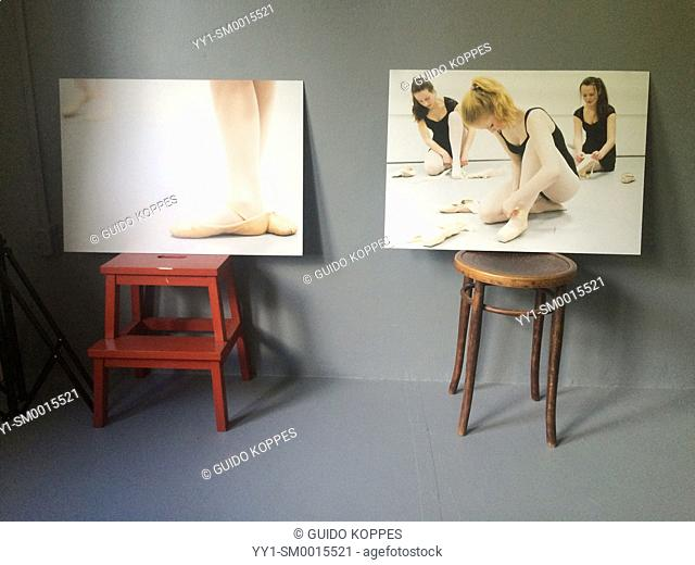 Tilburg, Netherlands. Two large format photo prints with ballerina's, placed on a stool in a photo-studio