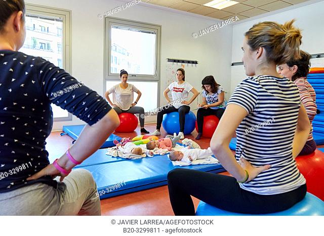 Mothers with babies in postpartum gymnastics, Health Center, Zarautz, Gipuzkoa, Basque Country, Spain