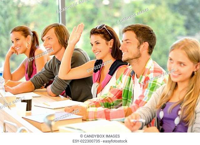 High-school student raising her hand in class
