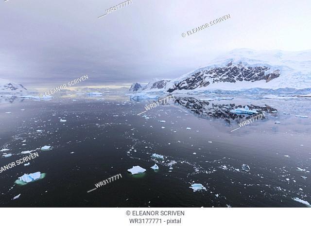 Atmospheric iceberg, mountain and glacier reflections, Neko Harbour, Andvord Bay, Graham Land, Antarctic Peninsula, Antarctica, Polar Regions