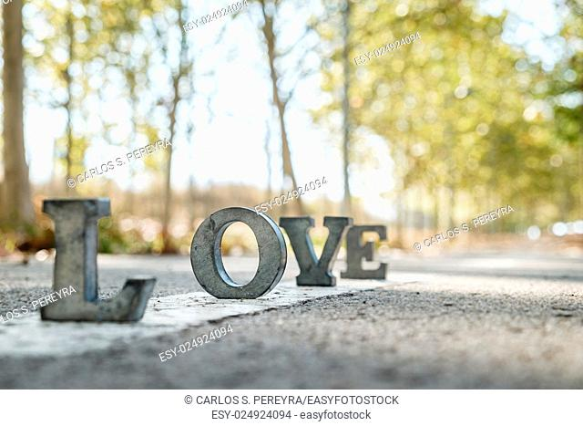 message of love with metal letters