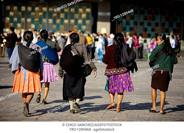 Indigenous women arrive the Our Lady of Guadalupe Basilica in Mexico City, December 8, 2010  Hundreds of thousands of Mexican pilgrims converged on the Basilica