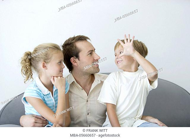 Father and 2 children on sofa