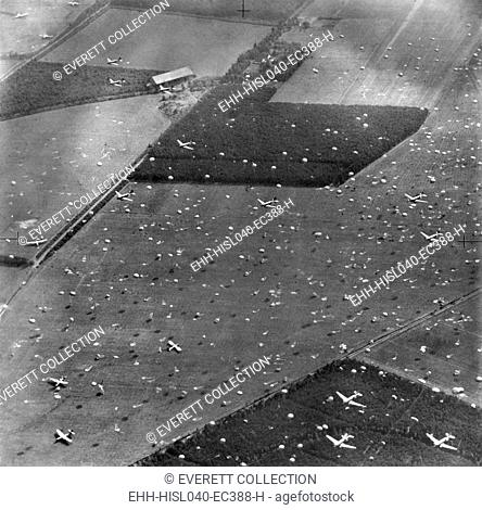 Allied planes drop paratroopers onto Holland's fields already dotted with gliders and airborne troops. Sept. 17, 1944. Field Marshall Montgomery's 'Operation...