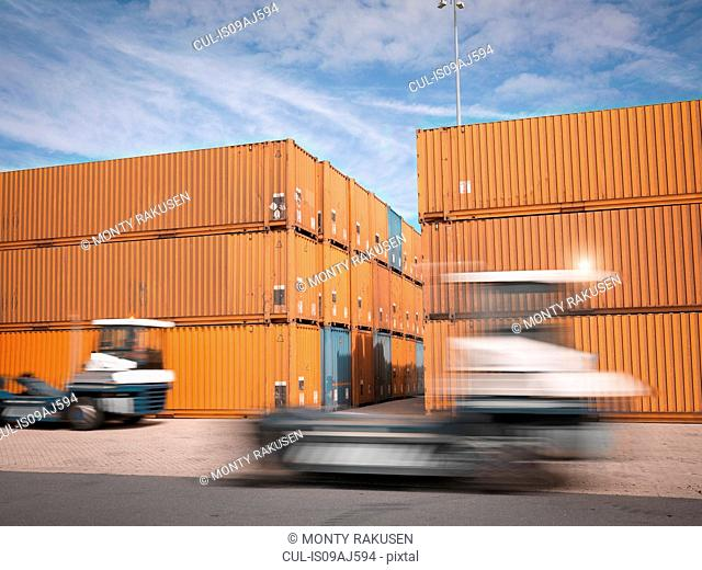 Trucks and shipping containers in port