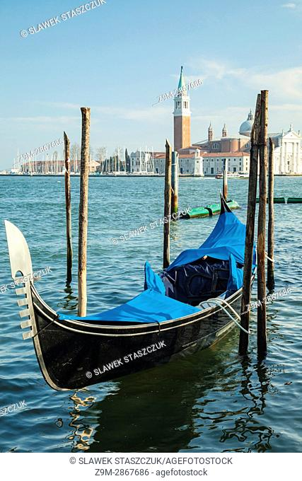 Gondola on San Marco Basin in Venice, Italy. San Giorgio Maggiore church in the distance