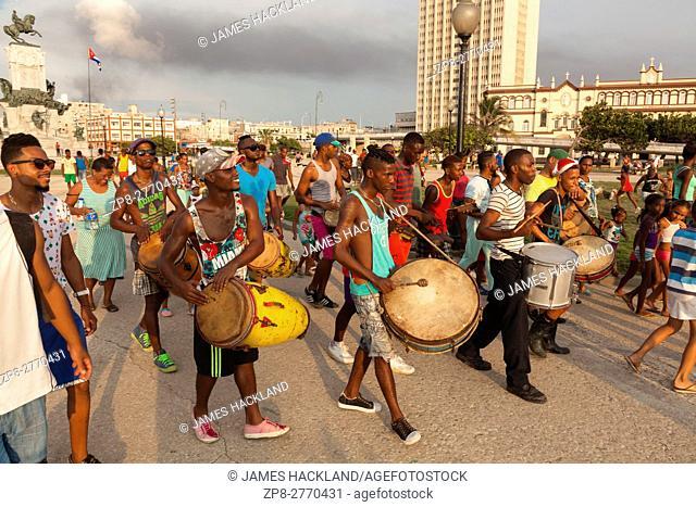 A group of musicians moving through Antonio Maceo Park in Central Havana, Cuba