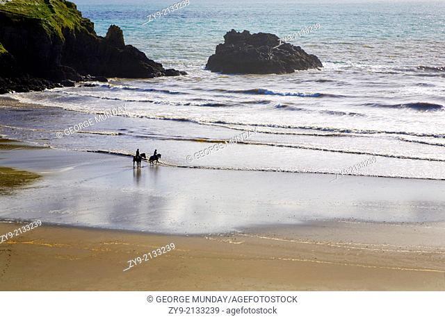 Riders on Stradbally Strand, the Copper Coast, County Waterford, Ireland