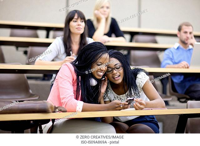 Two students looking at smartphone