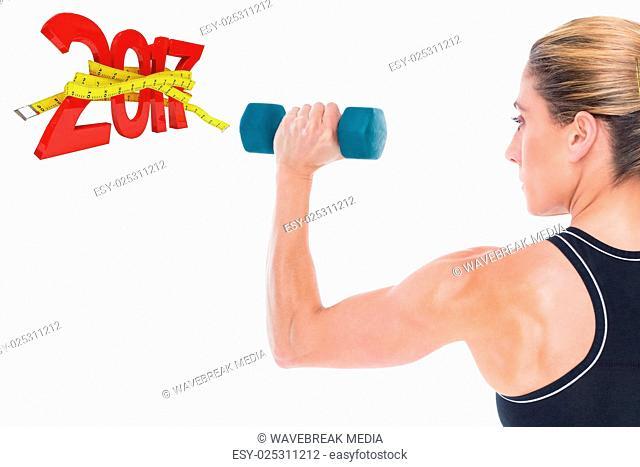 Composite image of female bodybuilder holding a blue dumbbell