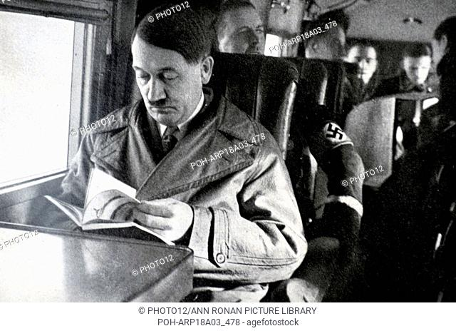 Adolf Hitler 1889-1945. seated on an aircraft. German politician and the leader of the Nazi Party driving a car. He was chancellor of Germany from 1933 to 1945...