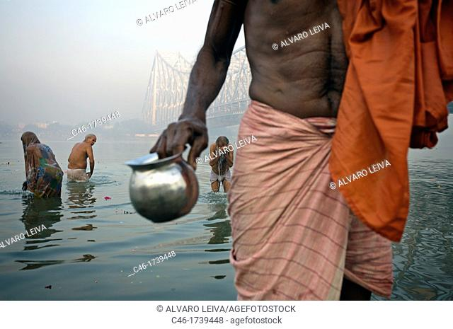 Sadhu by the Howrah Bridge, Hooghly River, Kolkata, India, Ganges River