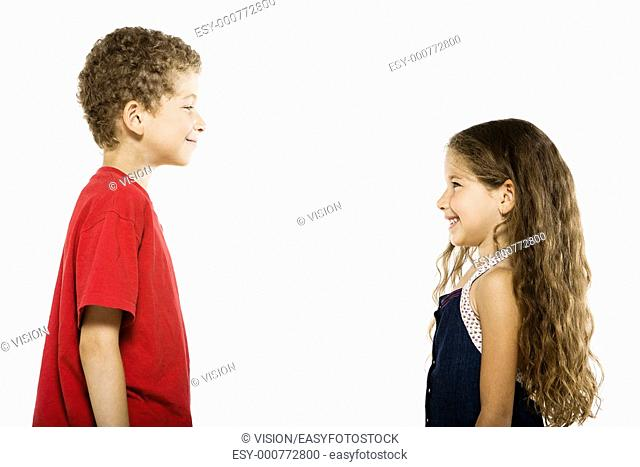 caucasian little boy and girl portrait complicity isolated studio on white background