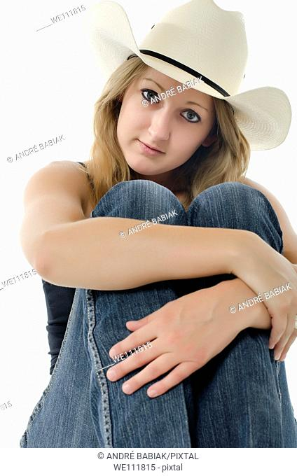Young cowgirl posing at studio