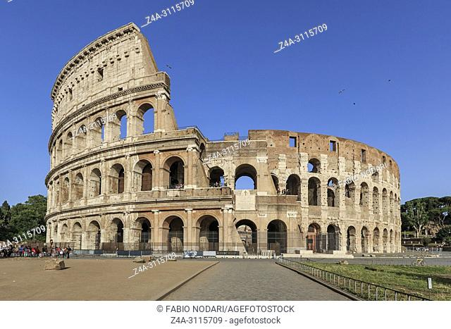 Rome, Italy - June 11, 2018: Coliseum on a sunny day in Rome, Italy, with a small group of tourists