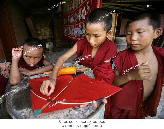 Temple school boys make a kite  Buddhist monks are living in monastries in and around Kathmandu  Many are illegal refugees from Tibet but live quietly within...