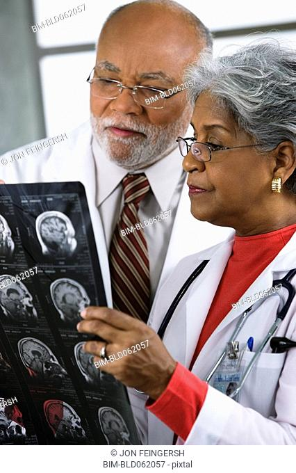 Two African doctors examining x-rays