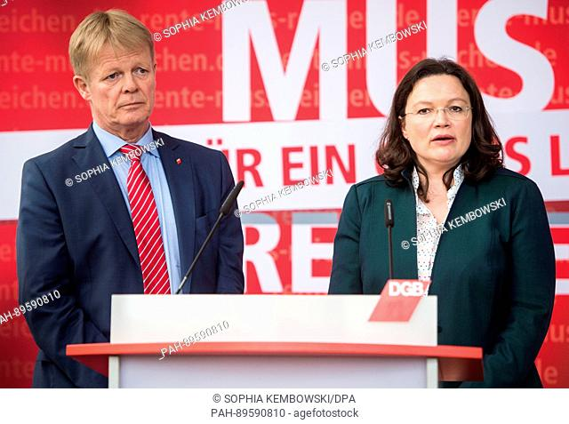 Reiner Hoffmann, chairman of the German trade union confederation (DGB) and the German minister of labour, Andrea Nahles speak during a press conference...
