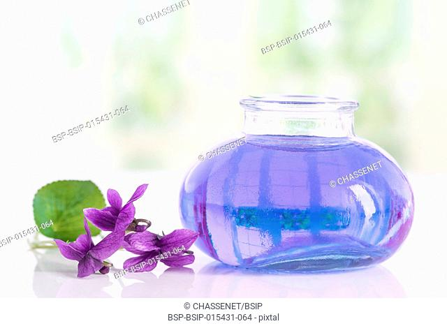 Raw materials for essential oils, organic cosmetics. Flowers with glass bottle