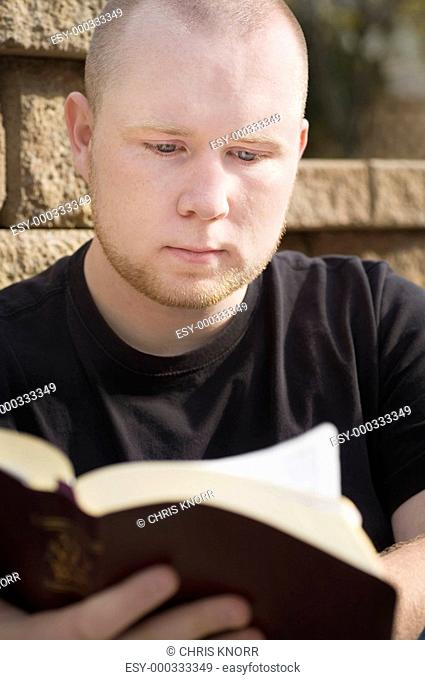 Man reading his Bible