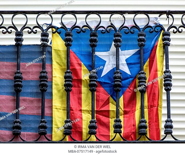 Catalan flag attached to a balcony in Barcelona