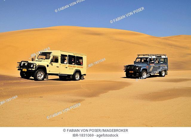 Safari vehicles in the dunes near Swakopmund, Namibia, Africa