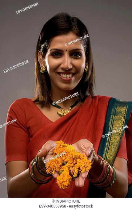 Woman offering flowers