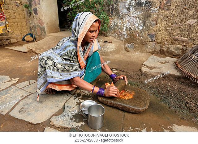Woman making tomato paste, KOND TRIBE, Taluka Saraipalli, Dist Mahasamundh, Chattisgarh, India