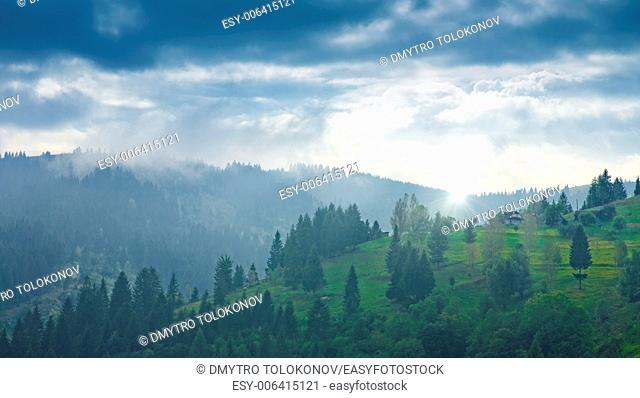 Carpatian valley with green hills and misty horizon, abstract natural landscape