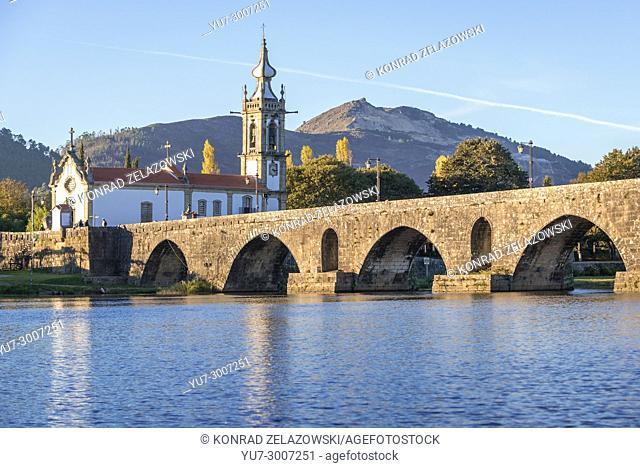Church of Santo Antonio da Torre Velha and Roman bridge over Lima River in Ponte de Lima city, part of the district of Viana do Castelo, Portugal