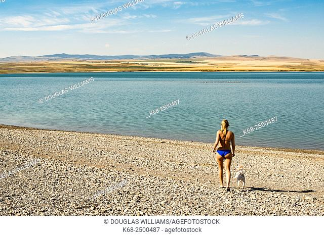 a woman, 19, on the beach near the Old Man River reservoir in southern Alberta, Canada