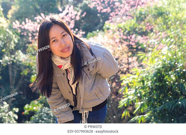 Beautiful Thai woman with Wild Himalayan Cherry, portrait rimlight