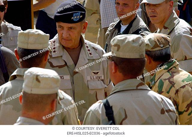 Army General Tommy R. Franks center Commander of coalition forces greets soldiers while visiting at Bagram Air Base Afghanistan on Aug. 24 2002